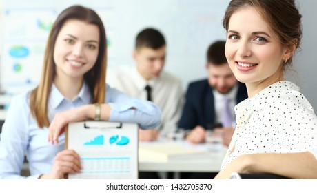 Young beautiful smiling clerk in office looking in camera headshot
