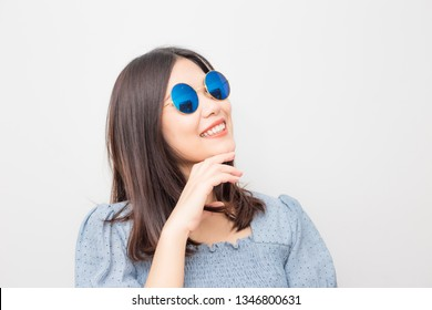Young beautiful smiling fashion asian women with sunglasses on white background