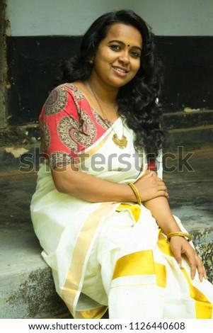 Young Beautiful Smiling Kerala Indian Girl Woman In Traditional Set Saree Kalamkari Blouse