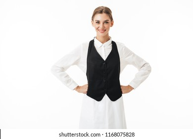 Young beautiful smiling woman in black vest and white shirt happily looking in camera over white background