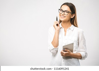 Young beautiful smiling woman in glasses holding pen, isolated on white. Business concept with tablet. Place for text.