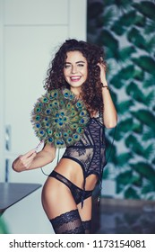 young beautiful smiling woman posing in black underwear