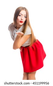 Young beautiful smiling woman in a red skirt posing in studio isolated on white background.