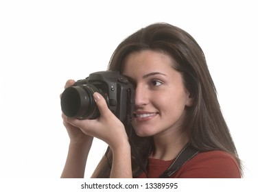Young beautiful smiling woman taking a photo with a camera