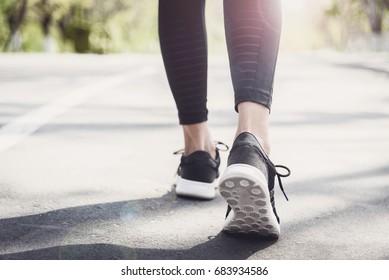 Young beautiful sportive girl preparing to run