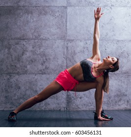 Young beautiful sportswoman doing exercises. Fitness