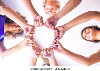 Young beautiful sportwomen doing gesture with hands