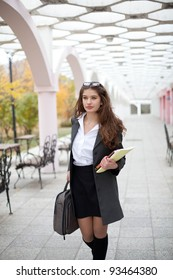 Young beautiful student girl with books