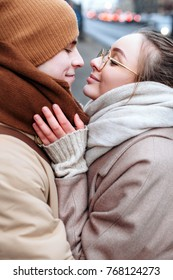 Young beautiful and stylish couple in love winter closeup portrait.