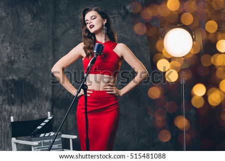 70ba3f0785d7 young beautiful stylish sexy woman, red evening dress, vintage retro style,  singing in