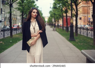 Young beautiful stylish trendy classy girl in long white dress and black blazer