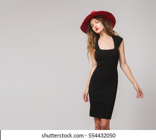 young beautiful stylish woman in black dress, red hat, red lipstick, sexy, elegant,