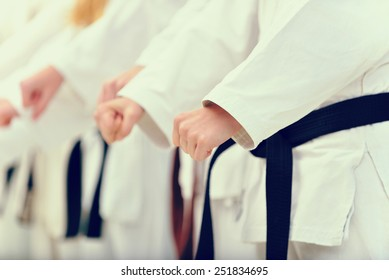 young, beautiful and successful karate woman and man in karate position