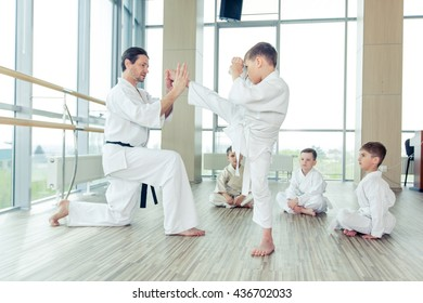 young, beautiful, successful multi ethical kids in karate position