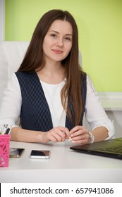 young beautiful successful woman is a prestigious job in the office. career