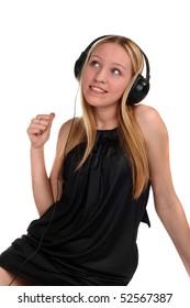 young beautiful teenage girl listening to music in headphones