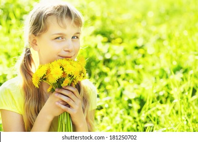 young beautiful teenager girl with dandelion bouquet