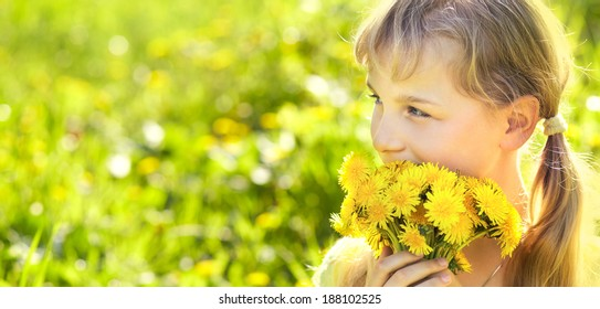 young beautiful teenager girl with dandelion bouquet. banner