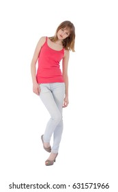 Young beautiful teenager on jeans over white background
