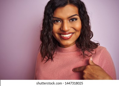 Young beautiful transsexual transgender woman standing over isolated pink background with surprise face pointing finger to himself