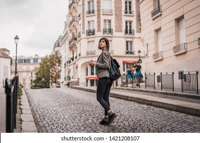 Young beautiful urban business woman going to work