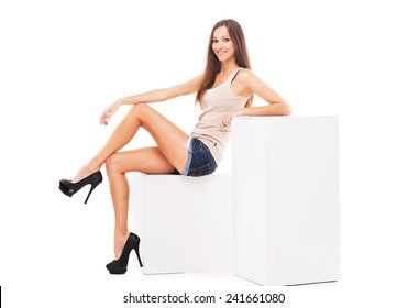 Young beautiful woman against white background