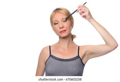 young beautiful woman applied powder on her face