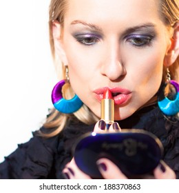 Young beautiful woman applying fashionable colorful party make-up.