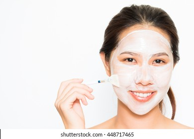Young beautiful woman applying yogurt facial mask Skin care, beauty treatments on white background