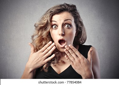 Young beautiful woman with astonished expression
