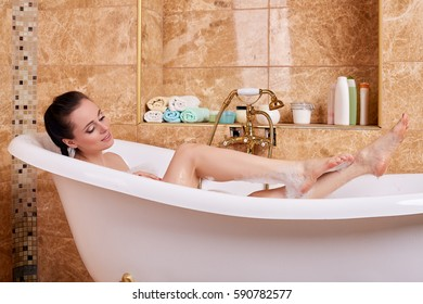 Young beautiful woman in a bathroom. Concept body care.
