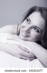 Young beautiful woman in bed