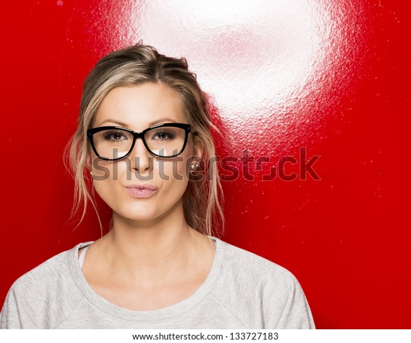 Young beautiful woman with black glasses.