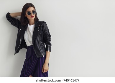Young beautiful woman in a black jacket