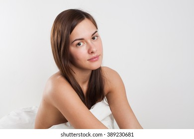 young beautiful woman in a blanket