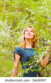 Young beautiful woman and blossomed tree