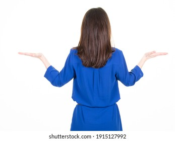 young beautiful woman in blue dress holding imaginary object on the palm back view isolated on white