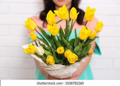 Young beautiful woman with a bouquet of tulips