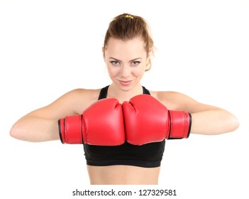 Young beautiful woman with boxing gloves at workout isolated on white