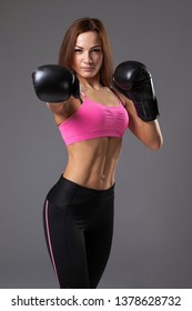 young beautiful woman with the boxing gloves