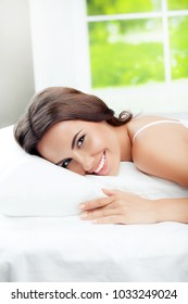 Young beautiful woman brunette waking up with pillow, at bedroom