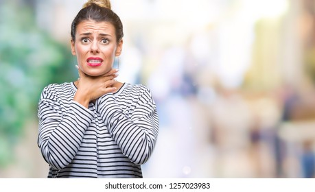 Young beautiful woman casual stripes sweater over isolated background shouting and suffocate because painful strangle. Health problem. Asphyxiate and suicide concept.