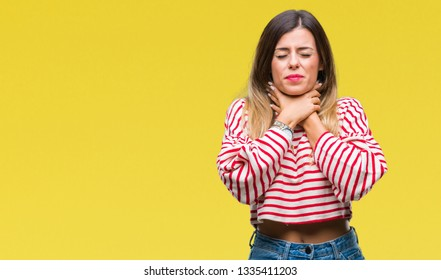 Young beautiful woman casual stripes winter sweater over isolated background shouting and suffocate because painful strangle. Health problem. Asphyxiate and suicide concept.