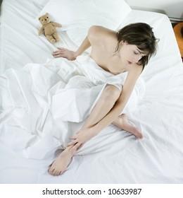 young beautiful woman caucasian in her bedroom