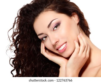 young beautiful woman with clean and long hair skin touching her face with hand over white background
