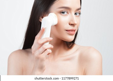 Young beautiful woman with clean perfect skin closeup. Skin care and age cosmetics concept