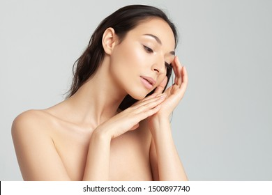 Young beautiful woman with clean perfect skin close-up.  Beauty, youth, skin care