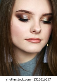 Young beautiful woman with closed eyes professional make up and hairstyle