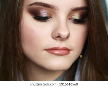 Young beautiful woman with closed eyes professional make up and hairstyle with