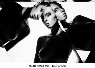 young beautiful woman with conceptual makeup isolated on white background. Pretty nude model pose in kaleidoscope. Art portrait with mirrors. Conceptual black-and-white photography. Fashion style